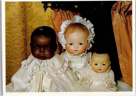 Drei Puppen von Armand Marseille , eine Negerpuppe