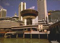 Singapore Clifford Pier with a revolving restaurant and skyscrapers Sin