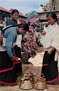 Kathmandu Typical women of Kathmandu valley preparing for worship Kathm